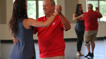 Tim Hickey dances the Argentine tango with Mimi Lamantia to build strength and balance after surviving cancer. Like many patients, Hickey suffered from peripheral neuropathy, which can occur when chemotherapy damages nerves in the legs and feet, causing balance issues.