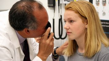 Dr. Christopher Giza examines Kennedy Dierk, 14, at the UCLA Steve Tisch BrainSport Clinic. A new survey shows most parents rely on outdated advice when caring for kids with concussions.