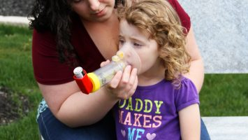 Joyce Kelso gives her 3 year old daughter, Karma, asthma medication through an inhaler in Columbus, Ohio.