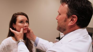 Dr. Robert Houser performs an exam on Kim Comisar following lip implant surgery. According to new data from the American Society of Plastic Surgeons, a record number of patients underwent lip implant surgery in 2015.