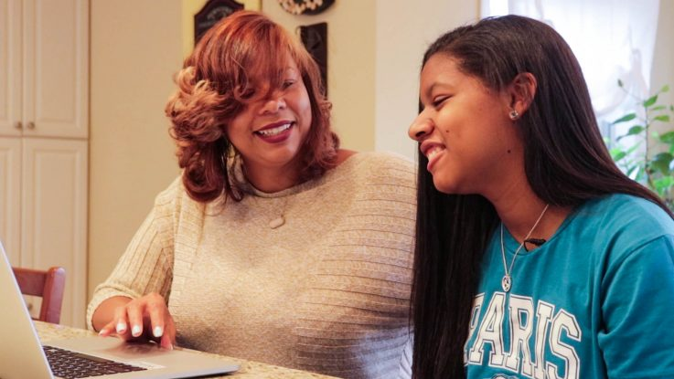 Tonisha Stills (left) clicks through photos from their trip to Paris with her daughter, Cimone. After struggling with severe epilepsy, Cimone was granted her wish of travelling to Paris, something her mom says not only gave her renewed hope, but helped reduce her seizures.