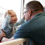 Joe Shields plays with his son, Jack, in his hospital room. A new approach to treatment for a chronic lung disease developed at Nationwide Children's Hospital helped Jack grow strong enough to finally be discharged from the hospital after 19 months.