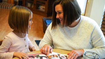 Kara Schooley reads with her 5-year-old daughter, Parker. Kara was closely monitored during both of her pregnancies because of the risks high blood pressure posed to her heart.
