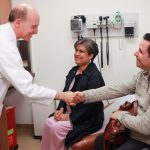 Dr. Abbas Ardhali greets Miriam and Louie Merianos in a follow-up appointment at UCLA Health. Dr. Ardehali led a team that performed a successful double lung transplant on Miriam, whose complicated case was denied by more than 20 other transplant programs